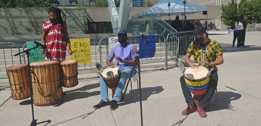 3 men drumming, fighting against anti-black racism