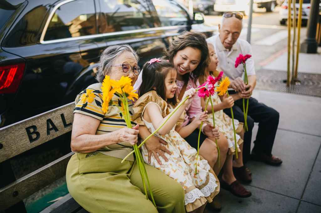 let love last all year, family sitting together with flowers